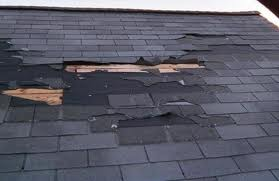 Advanced Roofing and Exteriors inspects storm-damaged roofs
