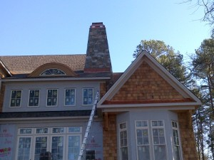Roof repairs currently in progress by Advanced Roofing and Exteriors
