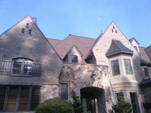 Charlotte roofing contractors working on a house
