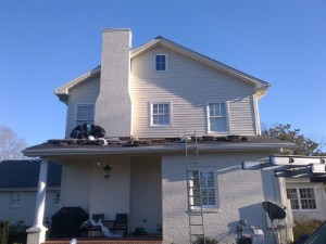 Roofing contractors working on roof repairs